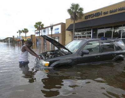 Irma downgraded to tropical depression; city flooding continues