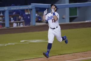 Dodgers clinch NL's top seed, West title with win over A's