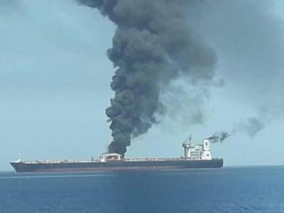 Photo shows oil tanker on fire off the coast of Iran after apparent attacks