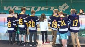 Ronald McDonald House Charities and WestJet surprise a Coach Dad for Father's Day