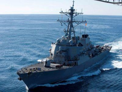 A Navy destroyer collided with a merchant vessel off the coast of Singapore