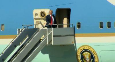 Trump, dogged by questions at home, makes first trip abroad