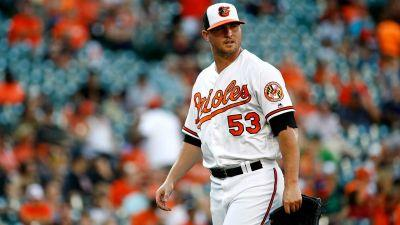 Britton blows save but Orioles beat A's in 12 innings