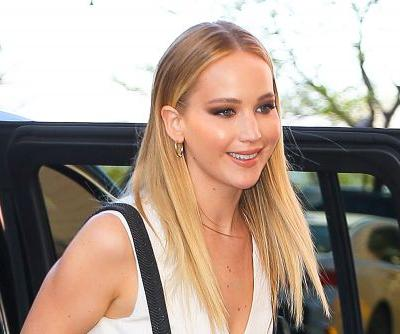 Jennifer Lawrence wears a pink wedding dress to her engagement party