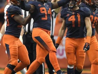 No. 13 Syracuse beats Louisville 54-23 perfect in dome