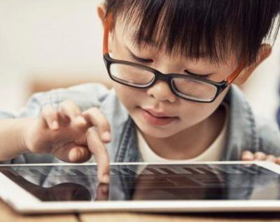 Kids should spend more time with screens, say new studies