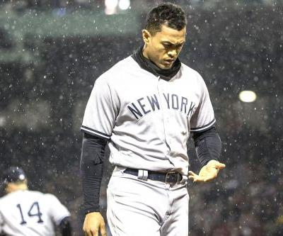 Yankees show little fight this time, fall to Red Sox at soggy Fenway