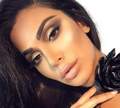 Why Huda Kattan Is Making 2018 the Year of the Beauty Micro-Loan and Loving Your Imperfections