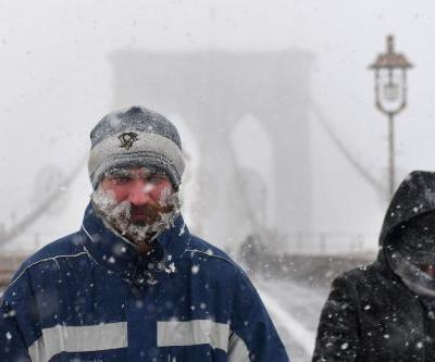 Photos show how the East Coast is frozen over in a 'bomb cyclone'