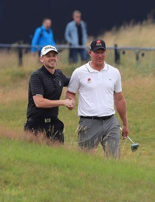 The Latest: Club pro plays as a marker at British Open
