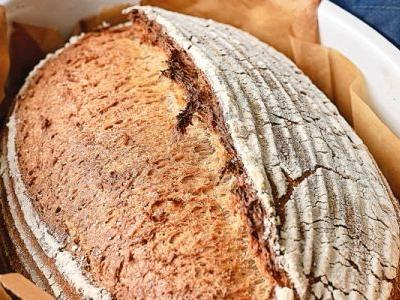 The Unexpected-Yet-Familiar Ingredient That'll Give You A Better Sourdough Loaf