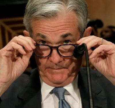 Stocks slide after the Fed hikes rates