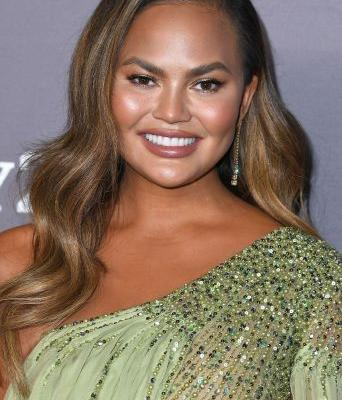 Chrissy Teigen Tried a New Hair Color For a Trip to The Grocery Store, And.Wow
