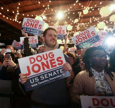 Black voters and affluent whites fueled Doug Jones' stunning election upset in Alabama