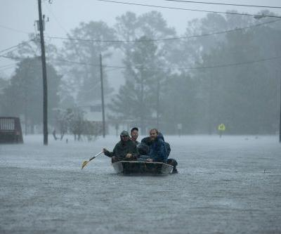 This couple spends their free time rescuing people in the aftermath of hurricanes - here's what it's been like for them in North Carolina
