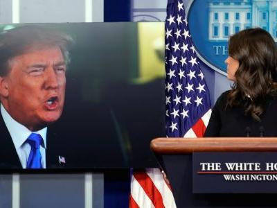 Twitter goes nuts after Trump makes an appearance at the White House press briefing - on giant screens next to Sarah Huckabee Sanders's podium