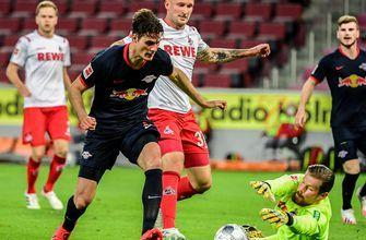 Leipzig overpowers Köln, 4-2, hops into third place in the Bundesliga table