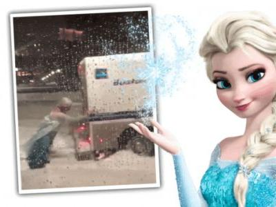 Watch A Man Dressed As Elsa From Frozen Shove A Stuck Police Truck Out Of The Snow