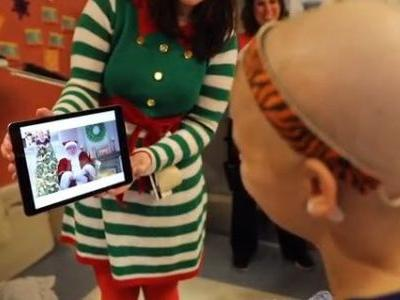Santa visits with patients, delivers gifts at Children's Hospital