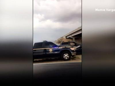 Caught on camera: Police chase woman who stole EMS vehicle