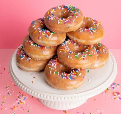 Krispy Kreme is selling a dozen doughnuts for just $1. Here's how to get some