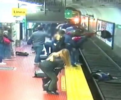 Woman falls onto subway tracks as train pulls into the station