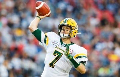 Harris throws 3 TD passes, runs for 2 others as Eskimos down Argos