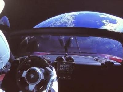 Here's why it says 'Don't Panic' on the dashboard of the car Elon Musk just shot toward Mars