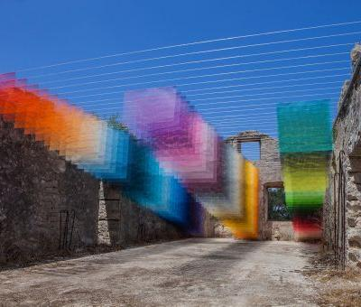 Colorful Installations of Spray Paint and Mesh Form Connections Between the Analog and Digital Worlds
