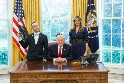 Rhode Island's 'sassy' Teacher of the Year posed next to Trump with a black lace fan - and Trump loved it