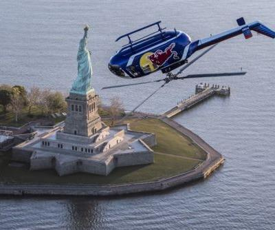 Photos of an Aerobatic Helicopter Doing Stunts Over New York City