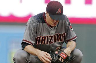 Twins gets to Greinke in big inning, shut out D-backs