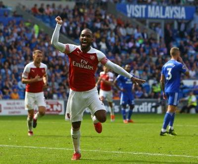 Lacazette lifts Emery as Arsenal subdue gritty Cardiff