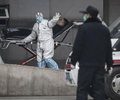 China reports sharp rise in SARS-like virus cases as holiday travel begins