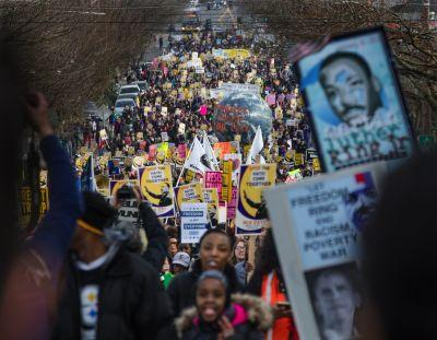 Thousands peacefully march, rally in Seattle to remember civil rights leader MLK Jr