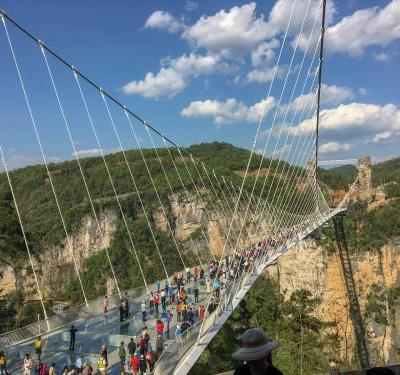 The glass bridge across China's 'Grand Canyon' is a trippy architectural marvel that's all over Instagram - but in real life, it's a tourist's worst nightmare