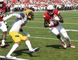 Jackson sets TD mark, No. 19 Louisville beats Kent St 42-3