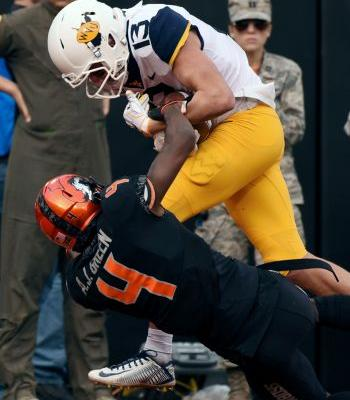 Cornelius leads Oklahoma St. past No. 7 West Virginia, 45-41