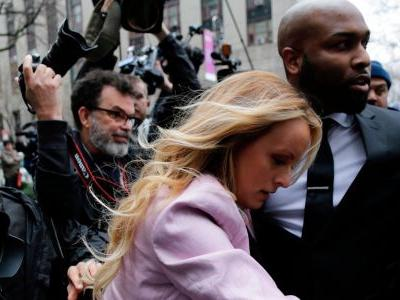 Photographers stumbled over themselves to capture Stormy Daniels attending Michael Cohen's hearing in a Manhattan courtroom