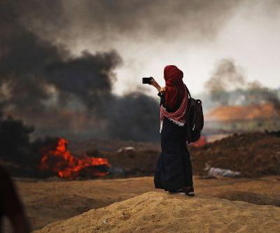 Female Palestinian medic killed by Israeli forces while treating injured protesters on Gaza border