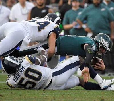 Eagles lose Wentz to injury, beat Rams 43-35 to win NFC East