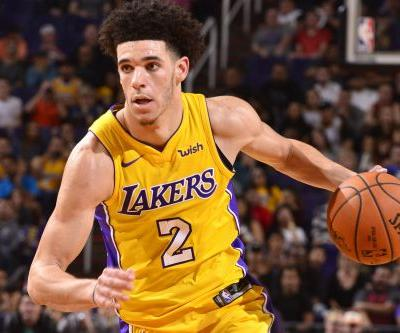 Lonzo Ball flirts with triple-double as Lakers pick up first win