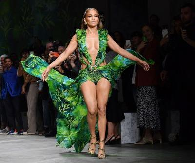 Jennifer Lopez closes Versace runway show in iconic green Grammys dress