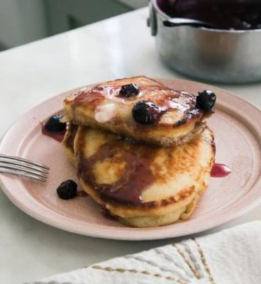 Comforting Banana Pancakes with Blueberry Sauce