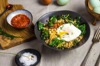 Stir-Fried Farro With Garlicky Kale and Poached Egg
