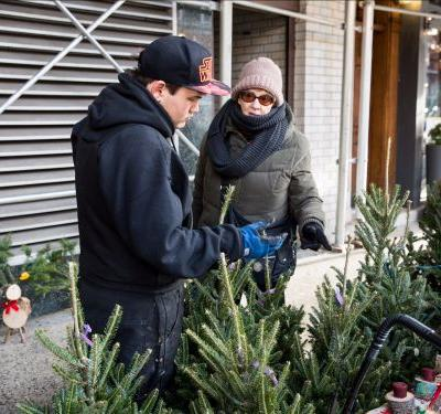 People travel thousands of miles to sell Christmas trees on the streets of Manhattan - meet an Alaskan family who has been doing it for 21 years