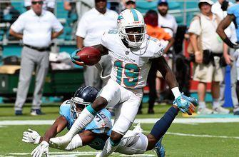 Dolphins start season with win after weathering Titans, 2 lightning delays