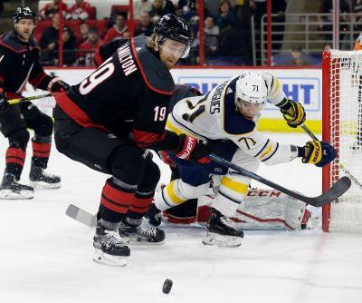Aho scores 2, Hurricanes beat Sabres 4-3 in Skinner's return