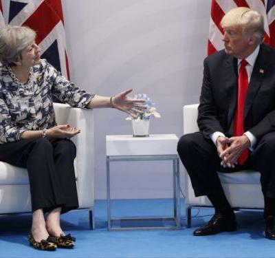 May warns Trump not to speculate about bombing after he's accused of revealing intelligence on Twitter