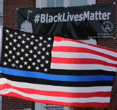 Oregon county pays $100,000 to employee who sued over Blue Lives Matter office flag